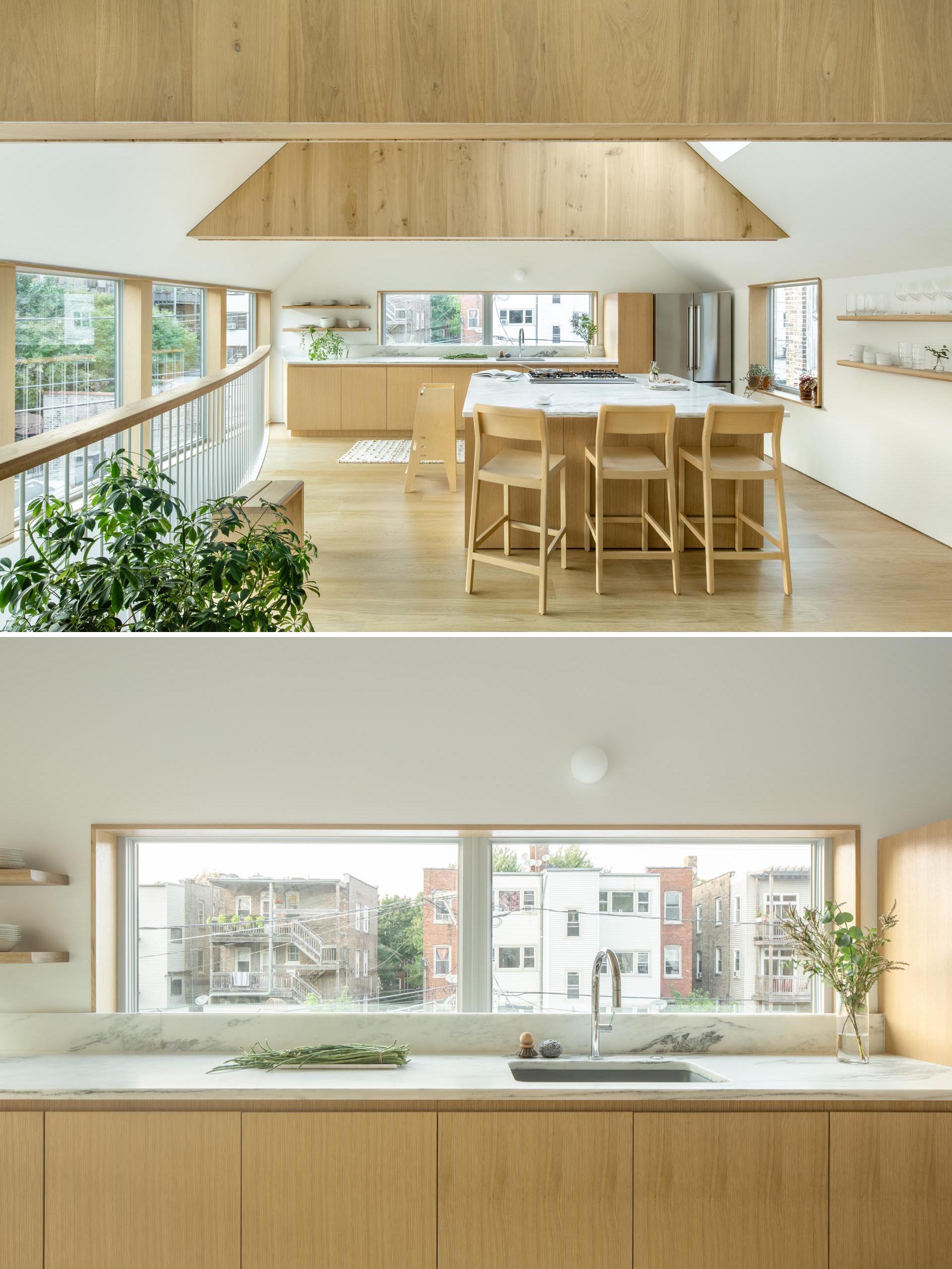 This modern kitchen has floating wood shelves, white countertops, and an island with seating.