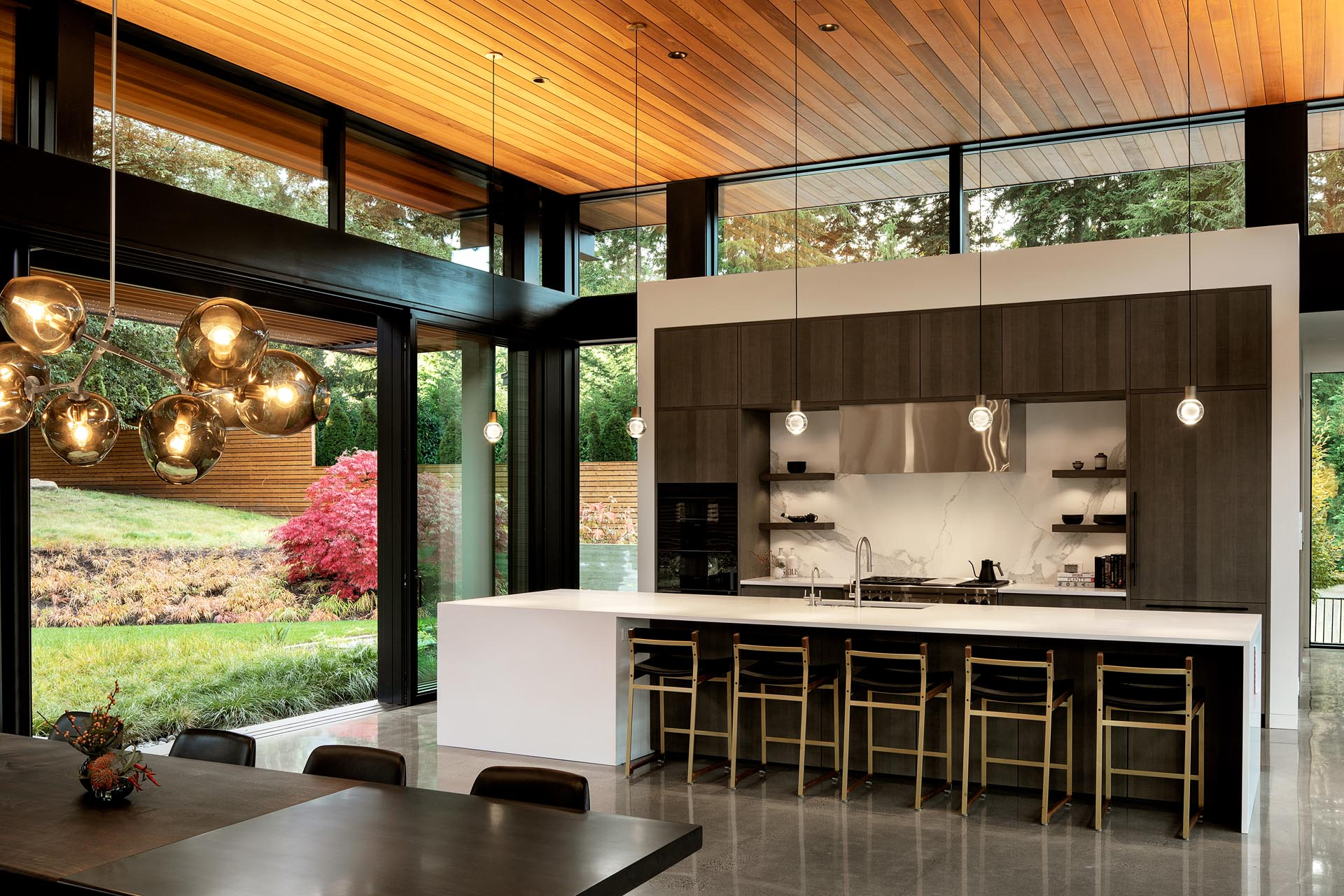 A modern wood and white kitchen with a long island.