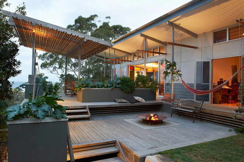 13 Multi-Level Backyards To Get You Inspired For A Summer Backyard Makeover // An entertaining area with a firepit and a dining area make up the two main levels of this backyard in Avoca Beach, Australia.