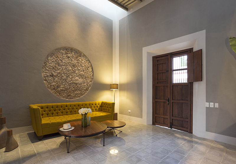 A section of original stone wall was revealed to create an artistic wall feature.