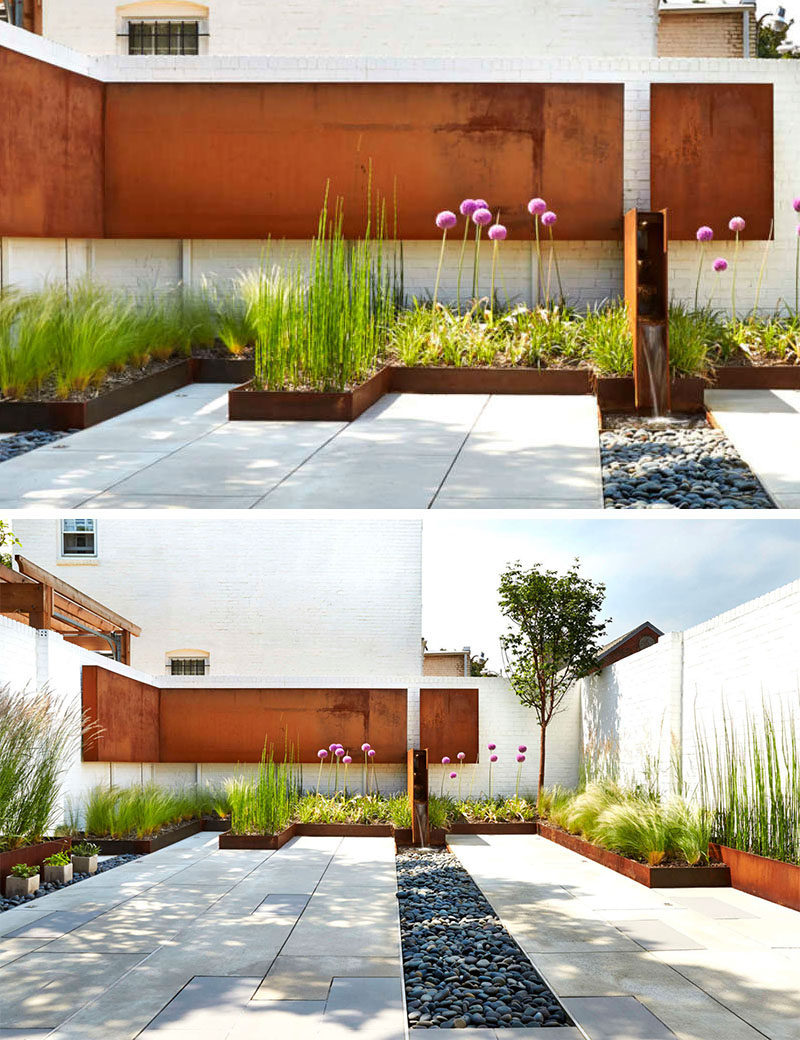 9 Ideas For Including Weathering Steel Planters In Your Garden // Short built-in weathered steel planters around the perimeter of this patio add color and texture to the space with the grassy plants keeping things soft and welcoming. #SteelGardenPlanters #WeatheredSteelPlanters #CortenSteelPlanters #Landscaping #GardenIdeas #PlanterIdeas