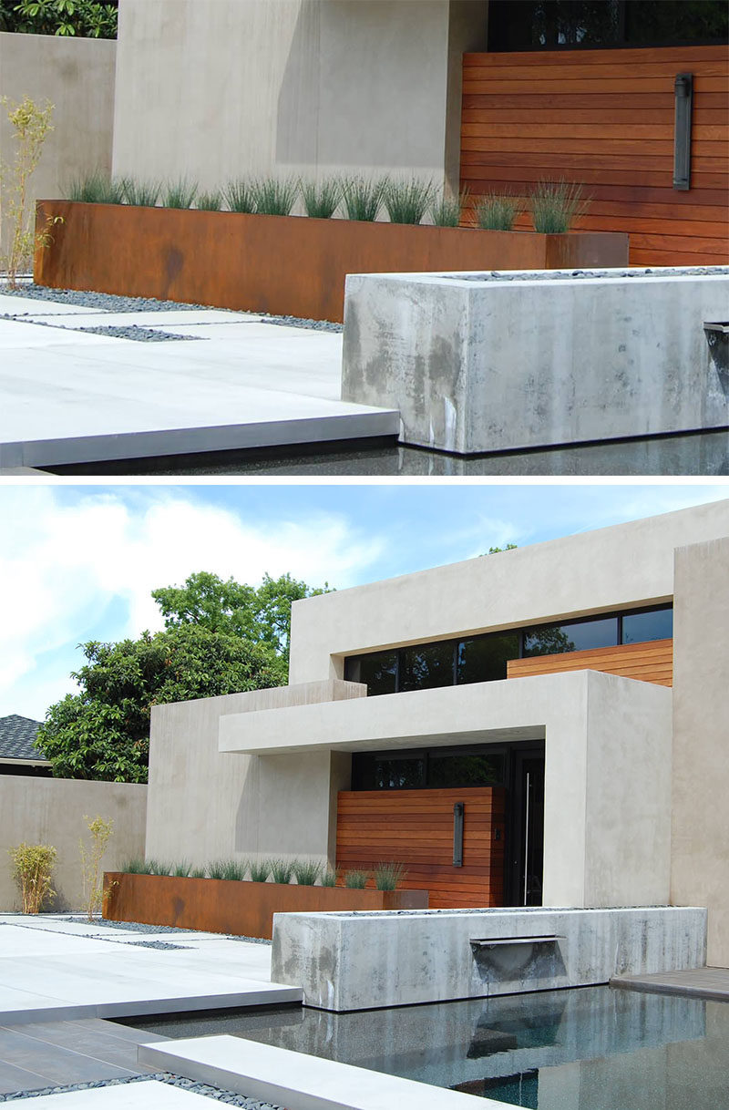 9 Ideas For Including Weathering Steel Planters In Your Garden // The color of the weathered steel of this oversized planter matches that of the wood doors on the exterior of this home and creates a tied together look and feel.  #SteelGardenPlanters #WeatheredSteelPlanters #CortenSteelPlanters #Landscaping #GardenIdeas #PlanterIdeas